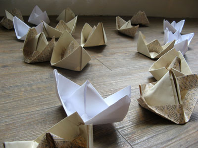 Close-up of origami boat installation